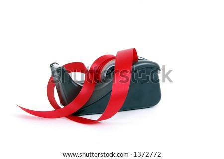A red tape dispenser - stock photo