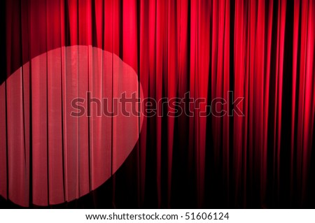 A red velvet stage curtain with a spotlight on it for effect.  Part of a series
