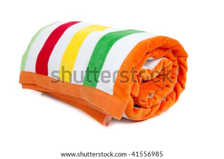 A red, white, yellow, green and orange striped beach towel on a white background - stock photo