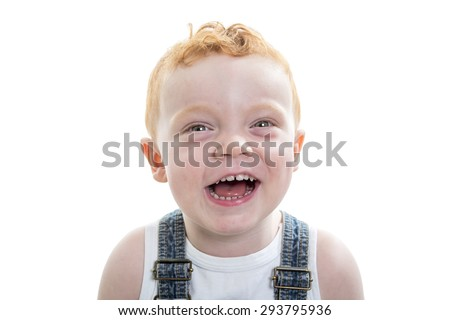 A redhead baby boy portrait over a isolated white background