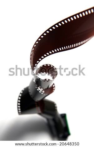 A reel of film rolling downwards, twisting the film along the way.