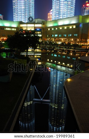 A reflection of Petronas towers on water - stock photo