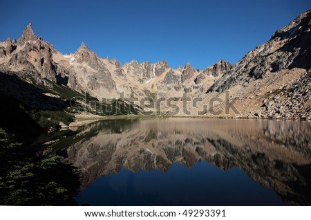 A reflection of the mountain around Refugio Frey in Argentina. - stock photo