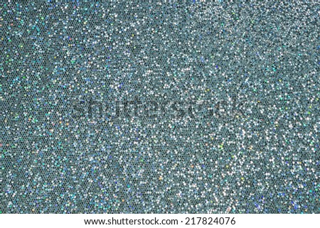 A reflective surface of blue and silver sequins - stock photo