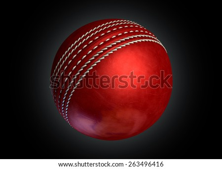 A regular red leather cricket ball on an isolated dark background