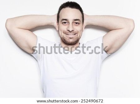 A relax man over a studio white background