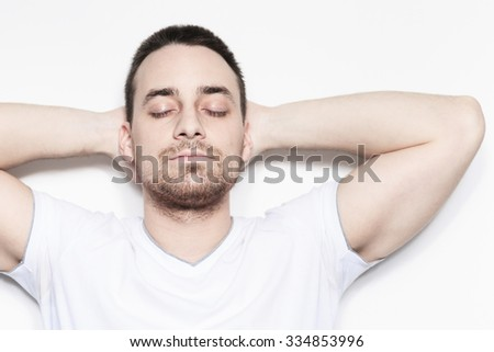 A relax man over a studio white background - stock photo