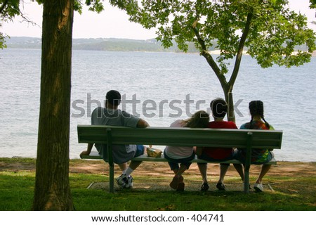 A relaxed family at the lake - stock photo