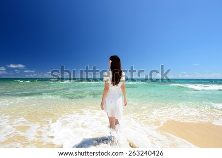 A relaxed woman on the beach.