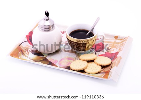 A relaxing cup of coffee with a biscuit.