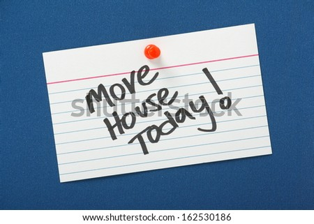 A reminder that you Move House Today written on a white note card pinned to a blue notice board. - stock photo