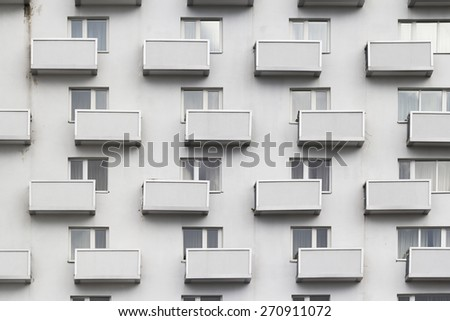 A repeating design of exterior: windows and balconies - stock photo