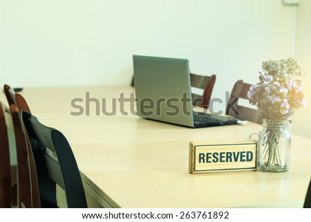 A reserved sign on a table at coffee cafe - stock photo