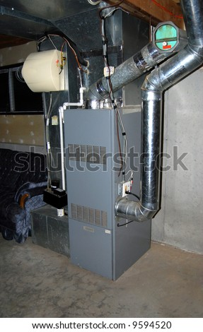 A residential oil furnace - forced hot air with central air conditioning and an in-line humidifier as well. - stock photo