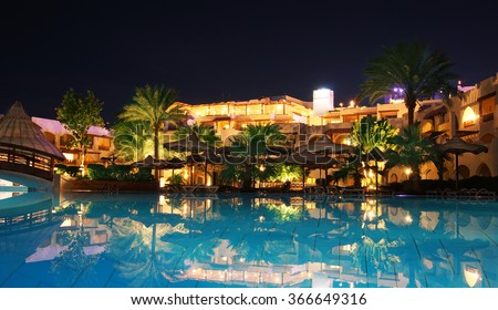 A resort swimming pool at twilight