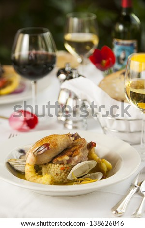 A restaurant dinner plate setting of fresh seafood.