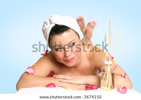 A resting woman ready for beauty therapy, massage or aromatherapy treatment - stock photo