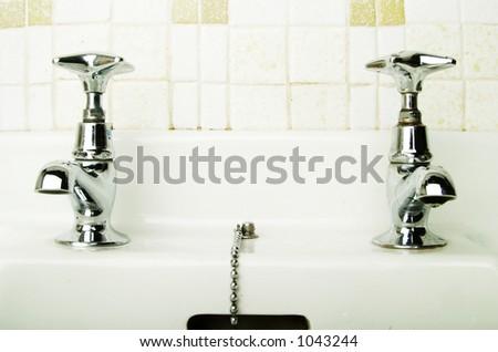 A retro bathroom sink tap. - stock photo