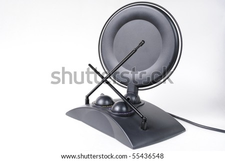 A retro television antenna with dish on white background. - stock photo