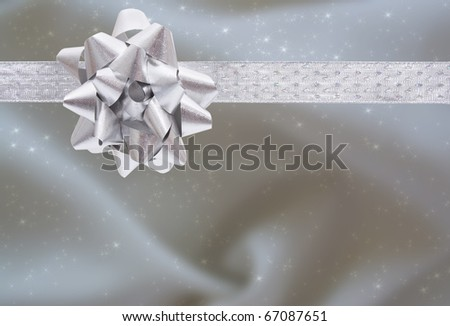 A ribbon and bow on a silver background, christmas present background - stock photo