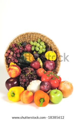 A rich bounty of autumn harvest foods spilling from a basket