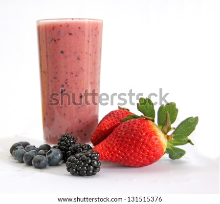 A rich smoothie drink with strawberries, blackberries and blueberries. - stock photo