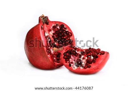 A ripe and juicy with nice bright pomegranate seeds - stock photo