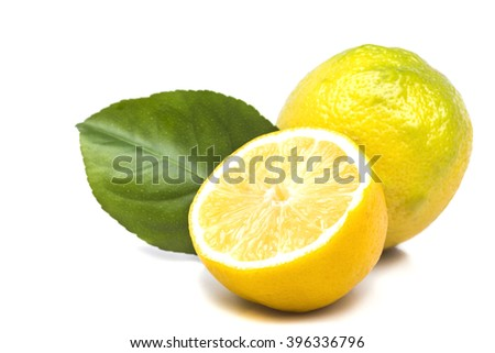 a ripe lemon with cut in half - stock photo