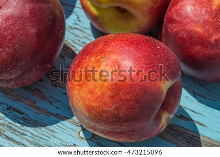 A ripe nectarine close up on the table