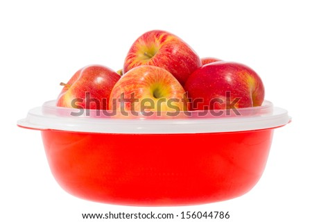 a ripe red apples on a plate
