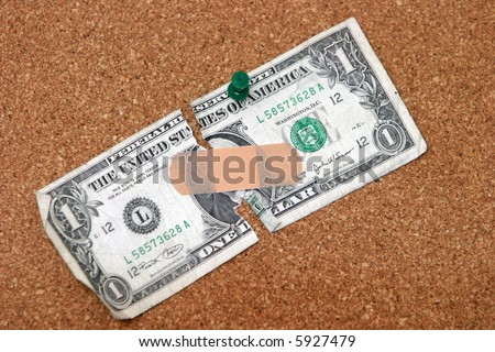 a ripped dollar bill with a bandaid sticking it together representing the broken mortgage industry and banking