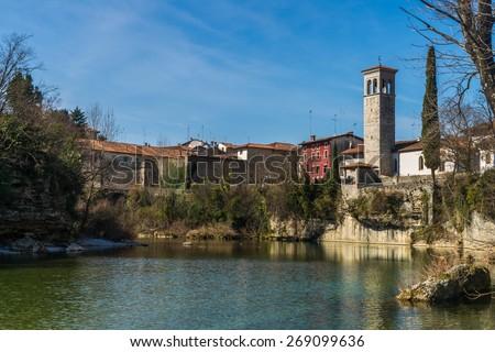 A riverside view to the Oratorio di Santa Maria in Valle in the city of Cividale del Friuli in Northern Italy - stock photo