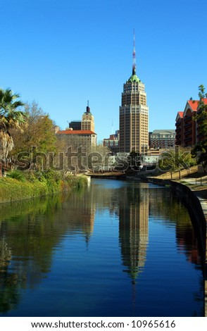 a riverwalk reflection of a tower in the San Antonio skyline - stock photo