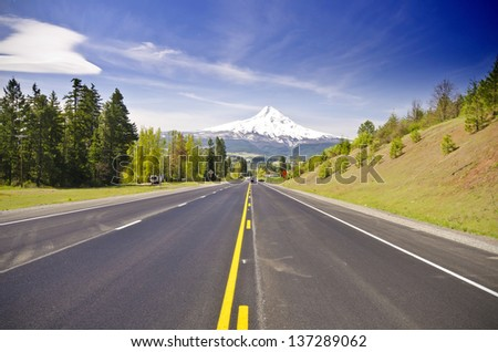 A road hits the mountain - stock photo