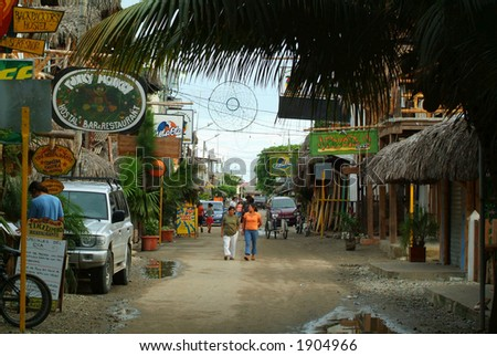 A road in a tropical town on the coast (South America) - stock photo
