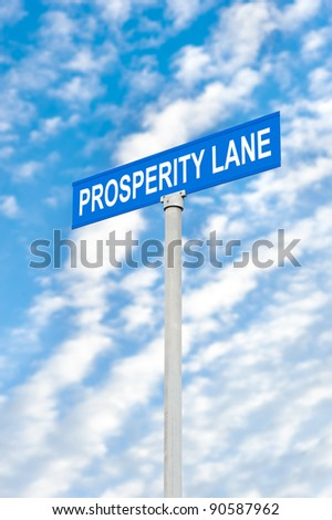 A road sign of prosperity against a blue, cloudy sky.