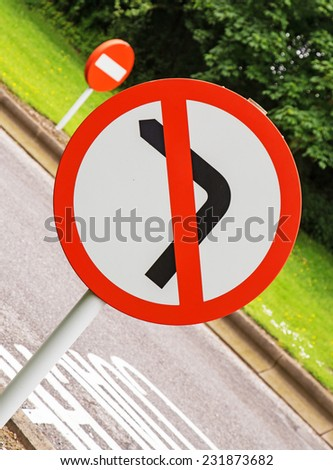 A road sign telling drivers they must not turn left, also useful as a concept. - stock photo