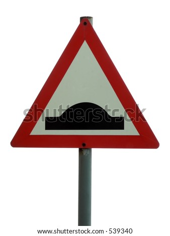 A road sign warning people about a speed bump ahead.