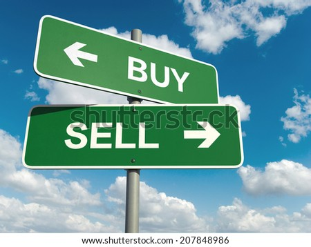 A road sign with buy sell words on sky background  - stock photo