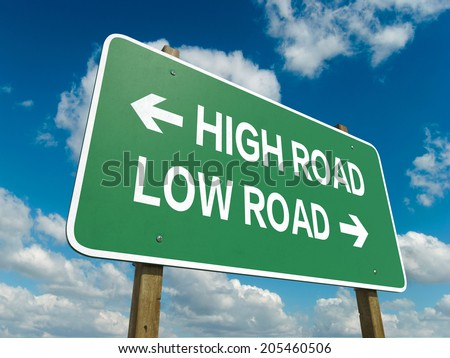 A road sign with high road low road words on sky background  - stock photo