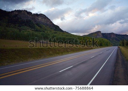 A road through the mountains and forest in Colorado