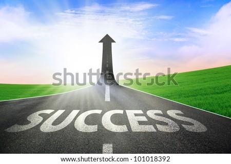 A road turning into an arrow rising upward symbolizing the improvement of success - stock photo