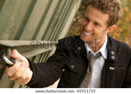 A Robber trying to break into a locked building - stock photo