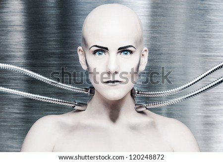 a robot girl connected with metal cables - stock photo
