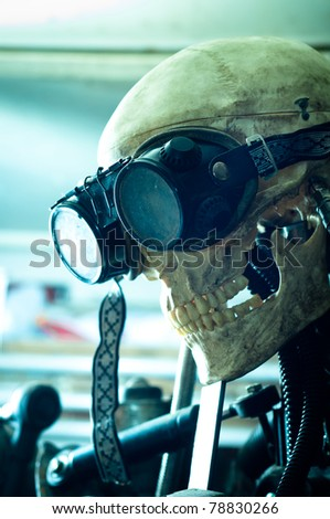 A robot with goggles in blue lights - stock photo