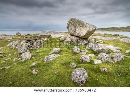 rock facing sea on coast connemara stock photo royalty free
