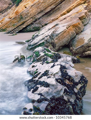 A rock formation along the California coast. - stock photo