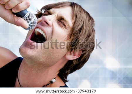 A Rock Star Jamming out with a microphone - stock photo