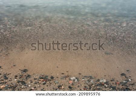 A rocky beach on Lake Superior.  Grand Marais, MI, USA. - stock photo