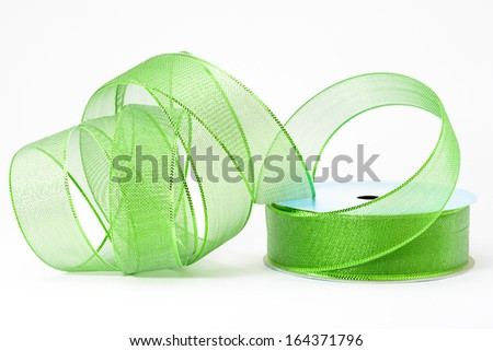A roll of decorative florist green ribbon - stock photo